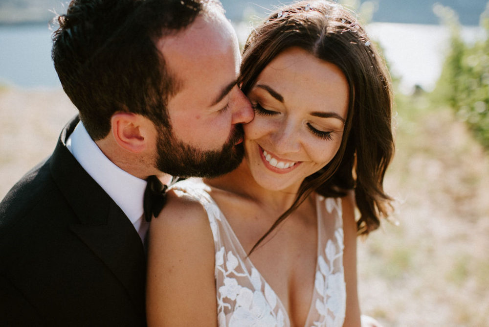 Dark hair bride and groom in the Okanagan. Hair and Makeup by Kathryn Ramsay Esthetics