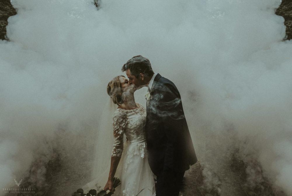 Smoky bride and groom wedding rustic moody