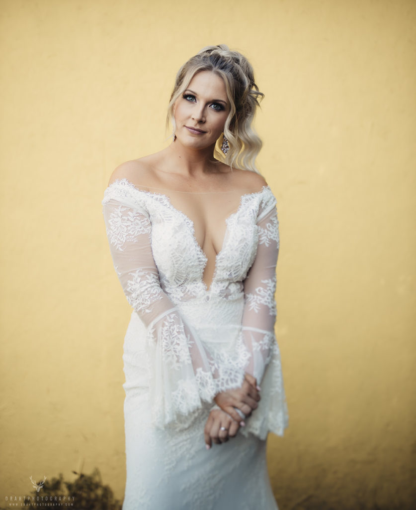 Blonde bride in wedding dress with yellow background